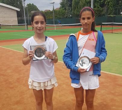 Girls winner and runner up holding winner plates