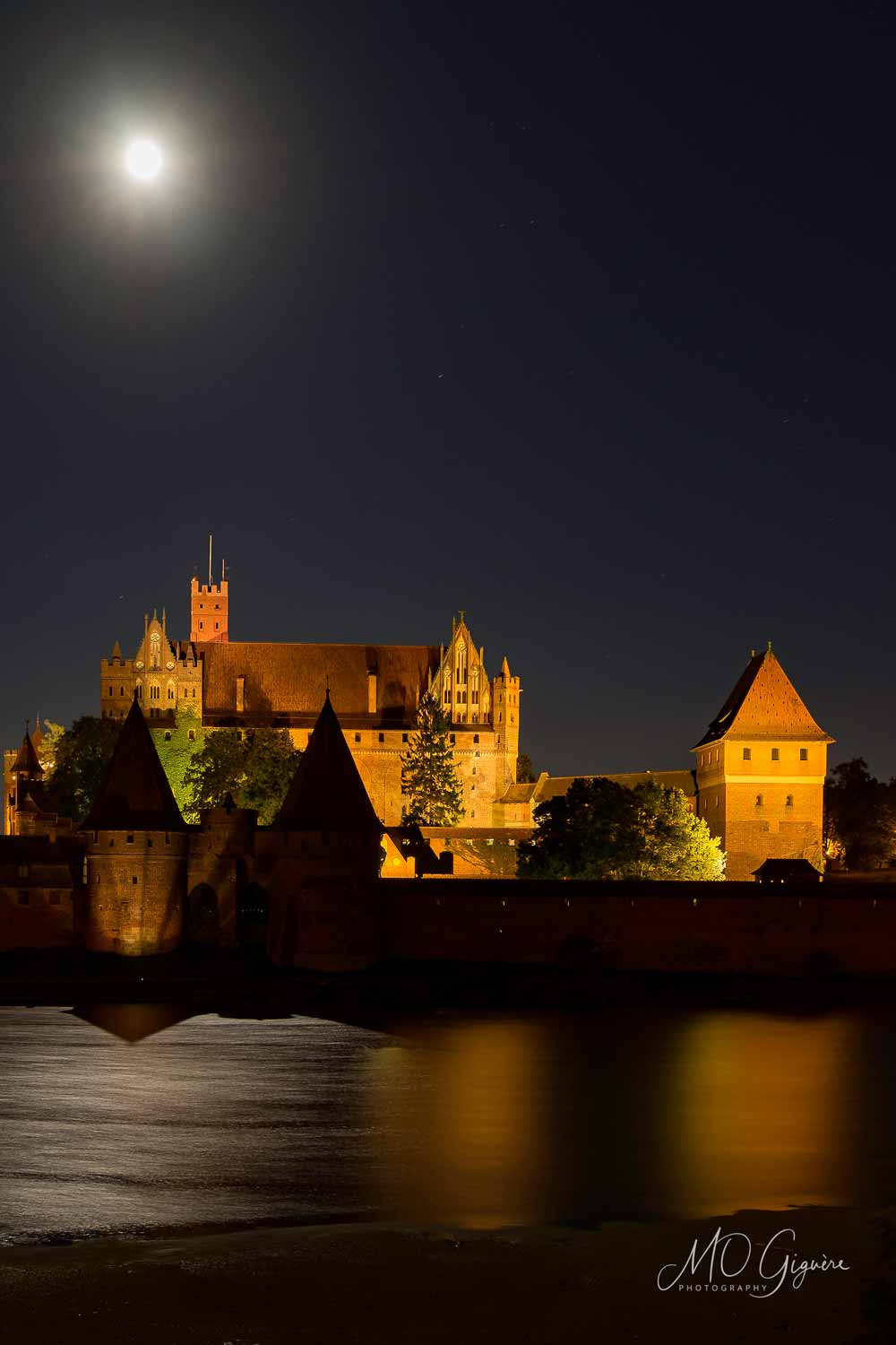 Malbork Castle and the full moon