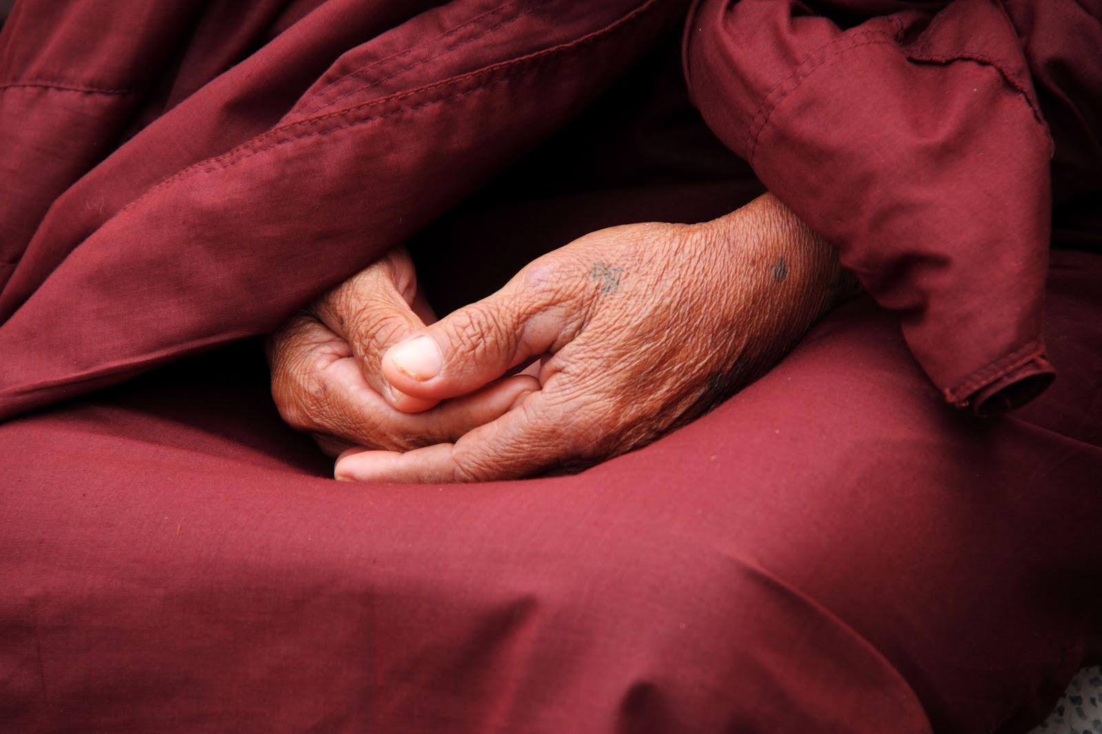 Close up of hands during meditation