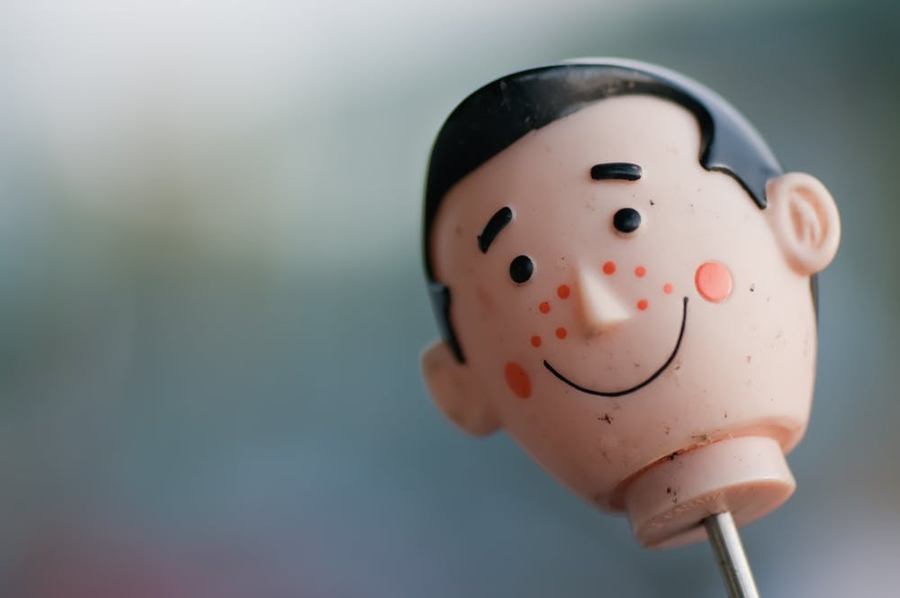a toy doll's head smiles