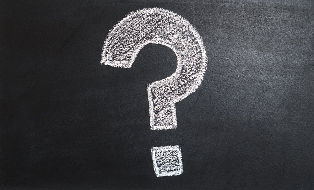 a question mark drawn on a chalk board, indicating that tms therapy research is ongoing