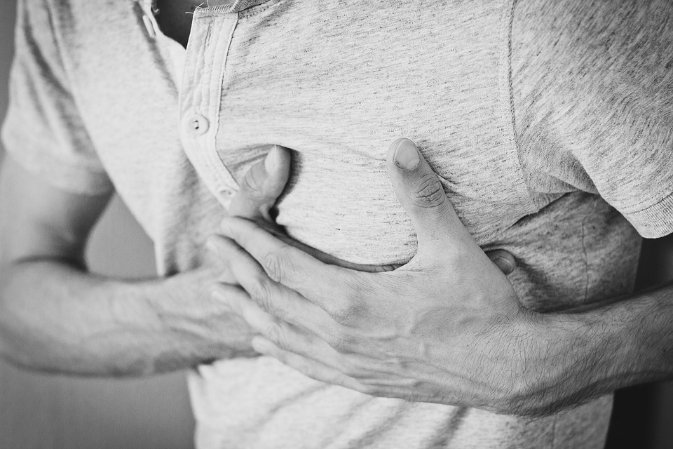 Person clutches chest in pain.