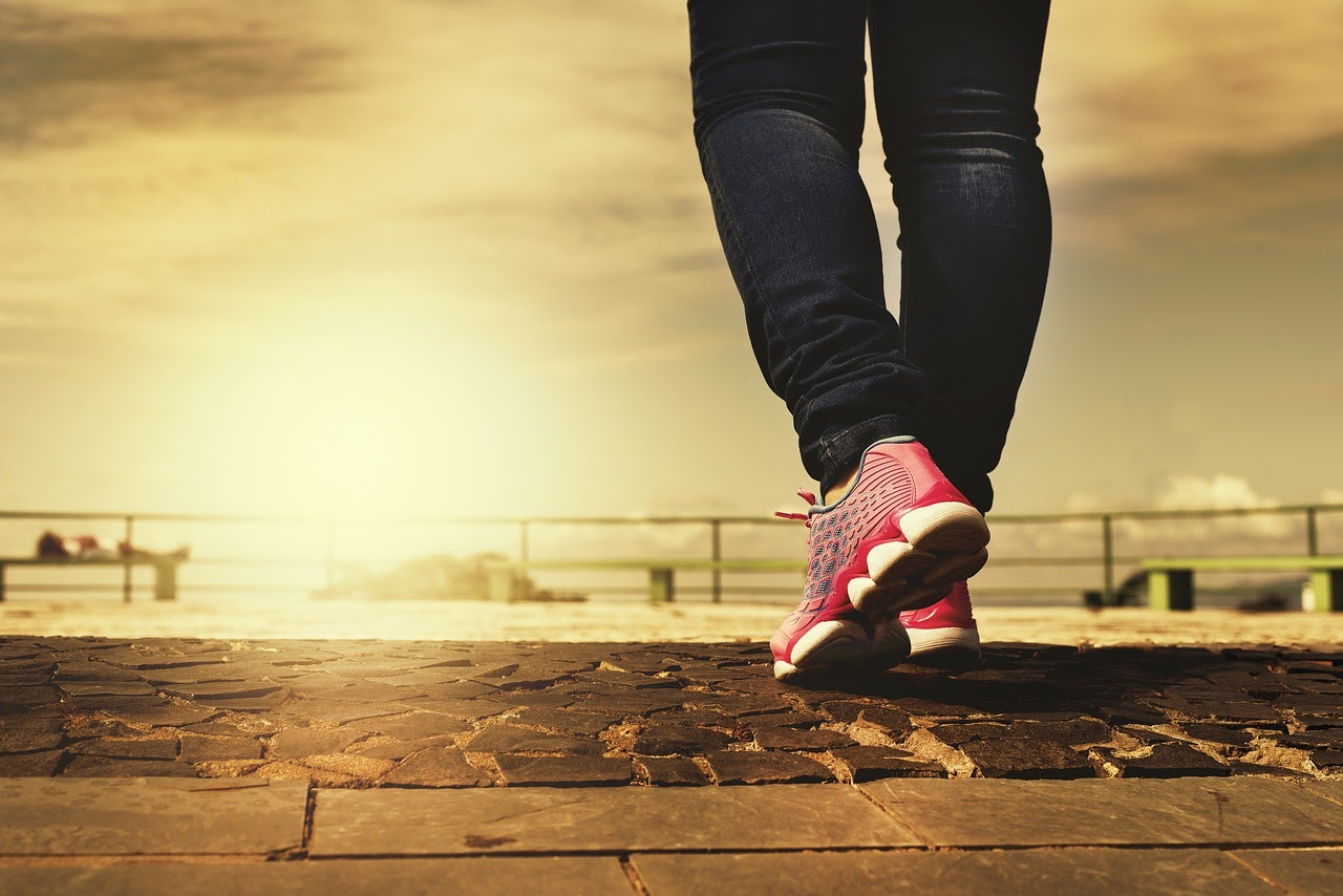 A woman is doing a walking exercise, one of the lifestyle changes a person can make to deal with depression.