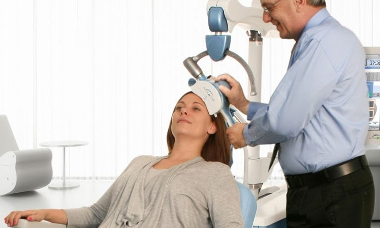 A patient receives TMS therapy.