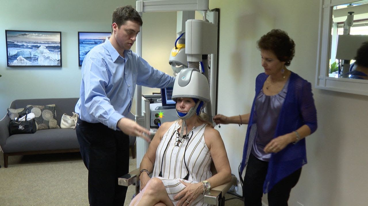 Woman preparing to receive TMS treatment for PTSD