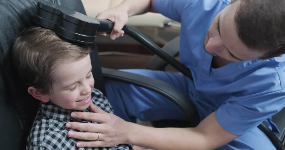 child getting tms treatment
