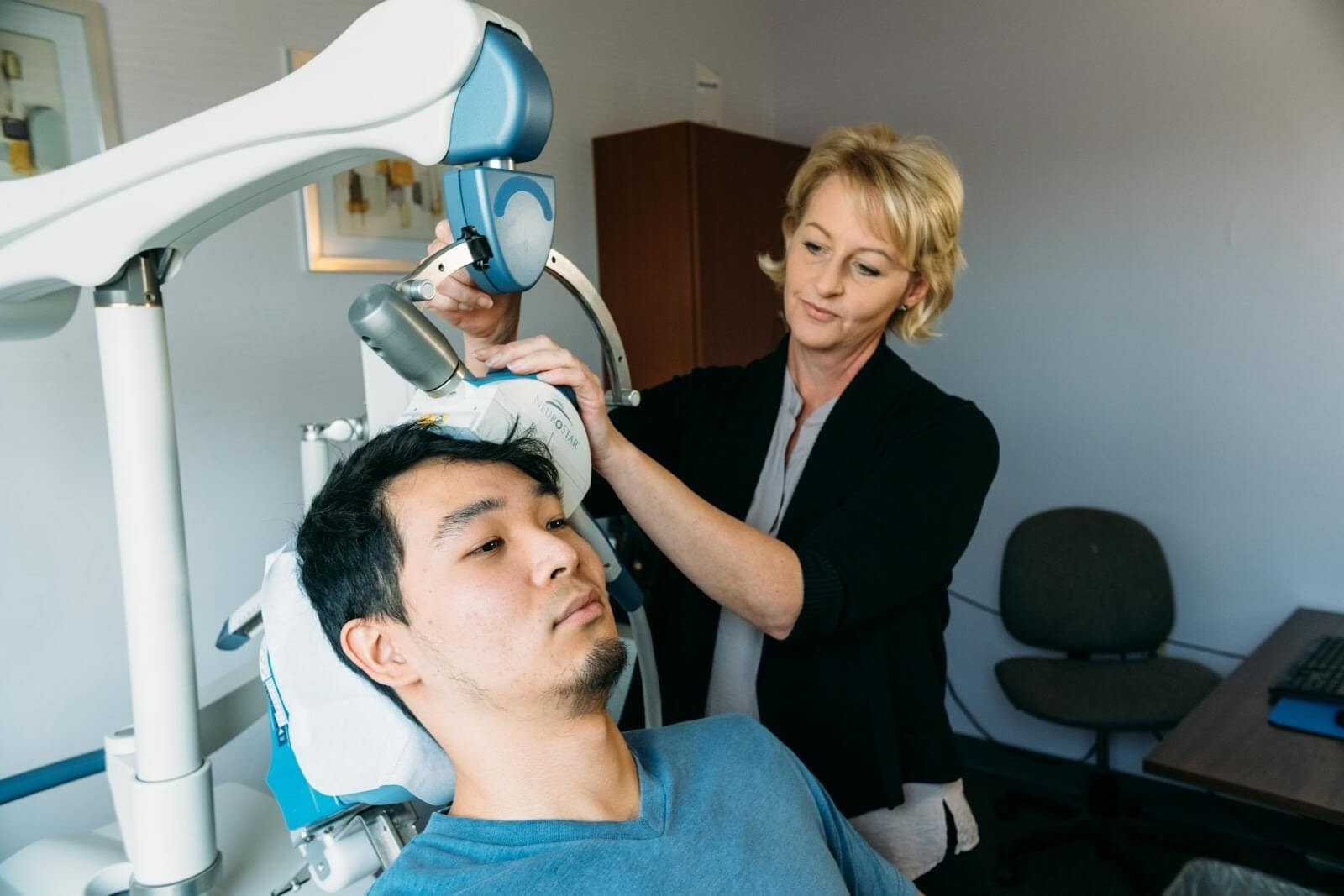 image of a man receiving TMS treatment