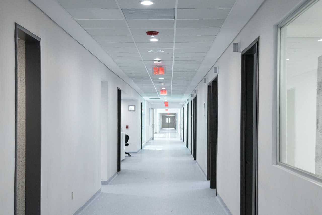 Empty white hallway in medical clinic
