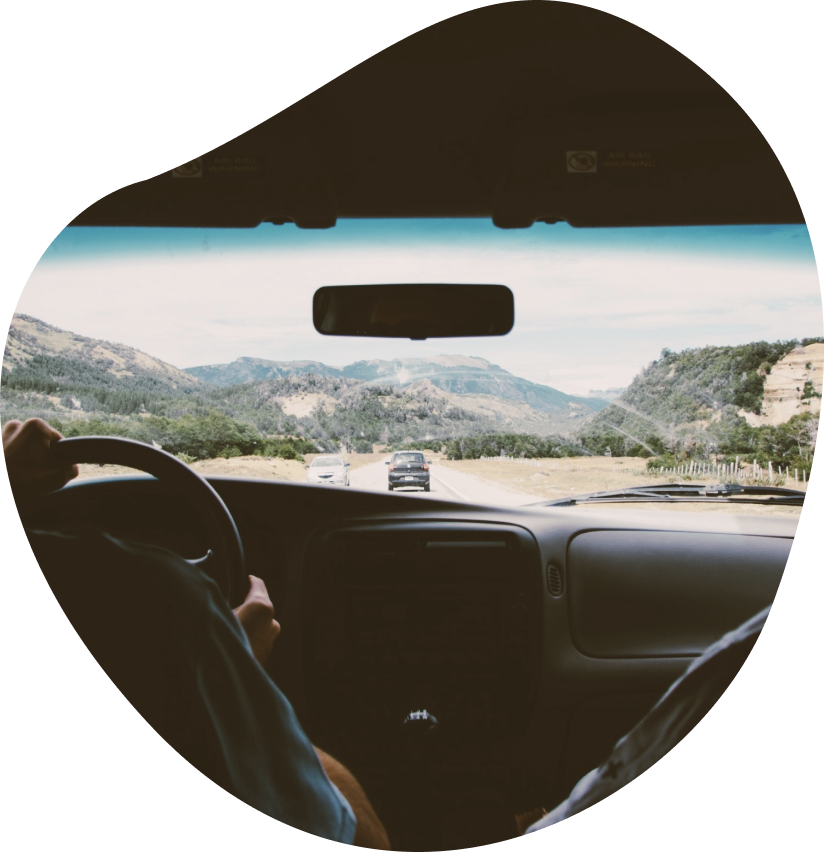 View out the windscreen from inside a car