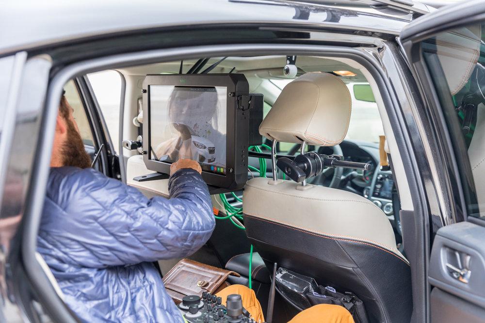 Drone Dudes crew member using a 19-inch Atomos Sumo monitor