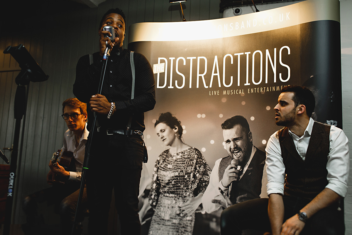 The Distractions Band singer and exhibition stand