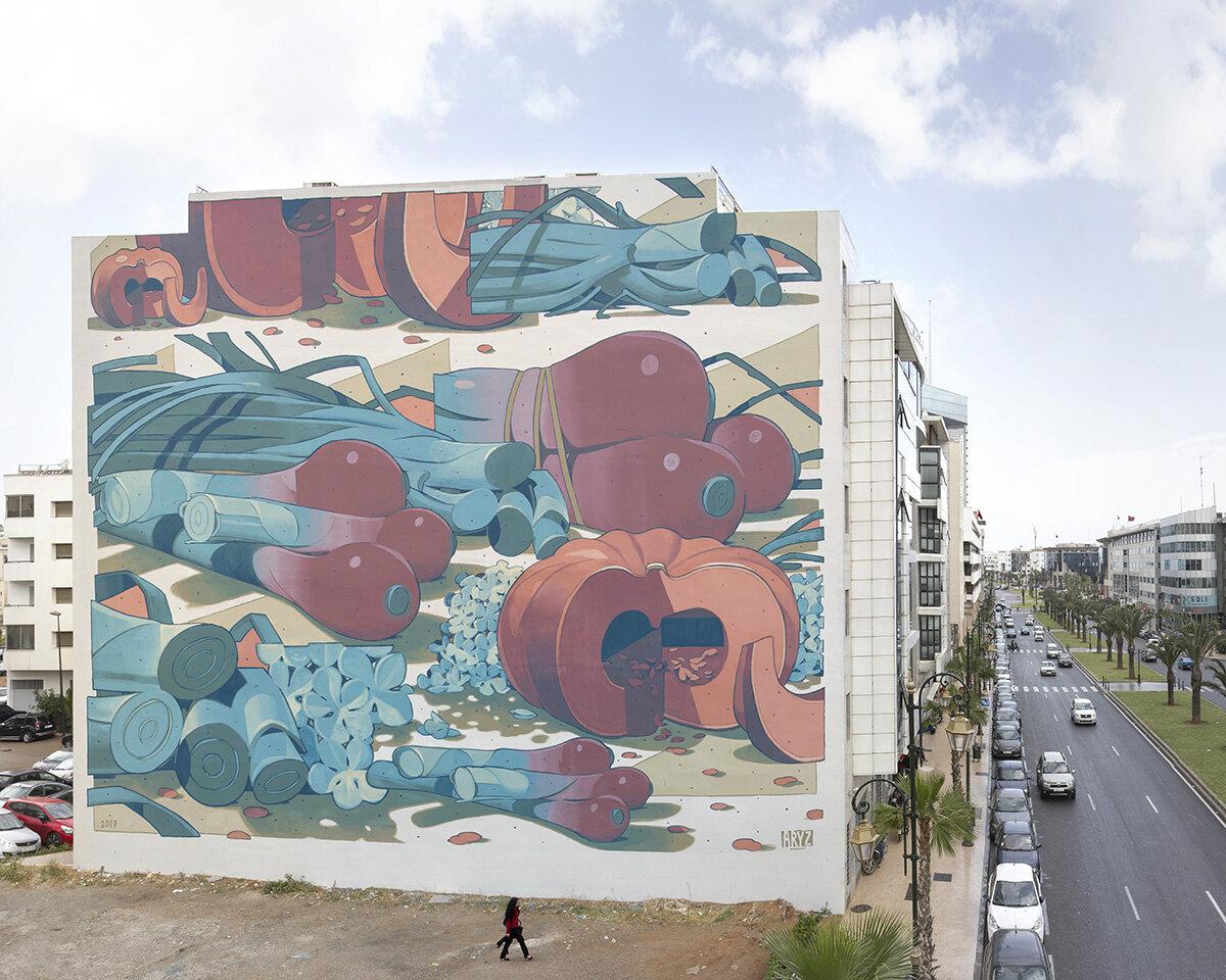 Fresque géante sur mur représentant des légumes