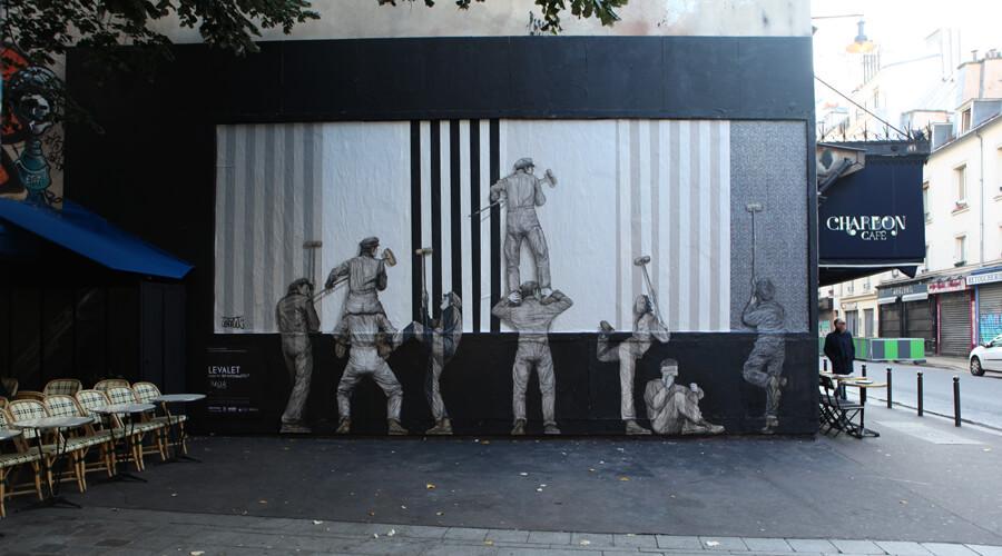 Fresque urbaine représentant des colleur d'affiche réalisée par Levallet