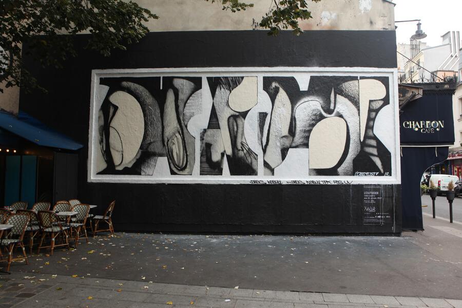 graff sur une affiche rue Oberkampf