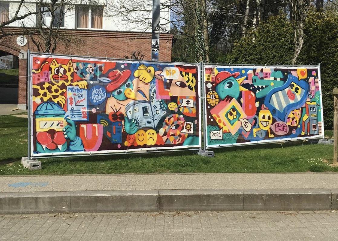 Fresque graffiti sur palissade de chantier à Lille