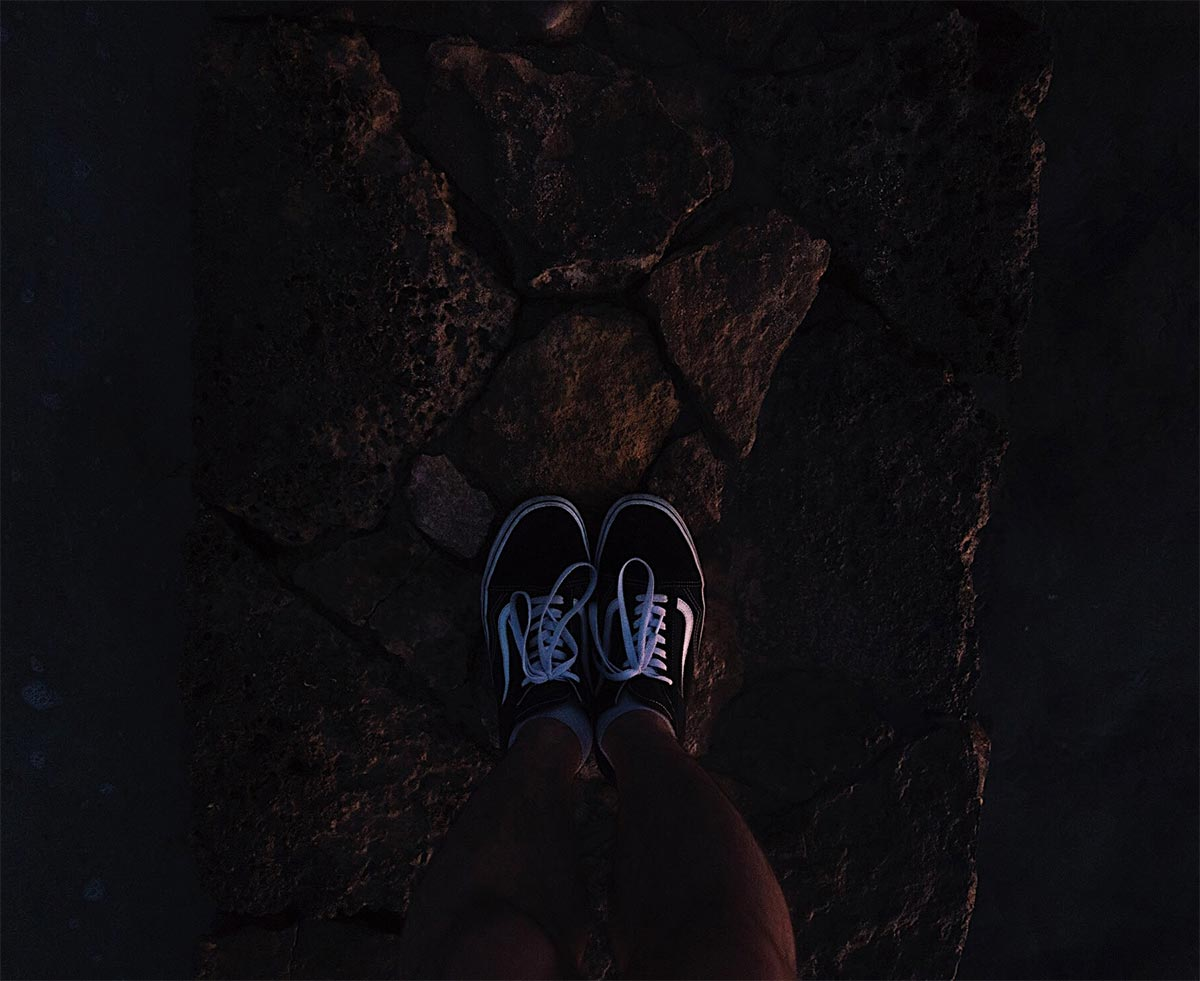 First person view of someone looking at their steps.