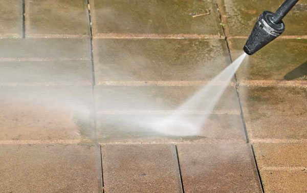 Pressure washing a pathway in Ashburn, Virginia