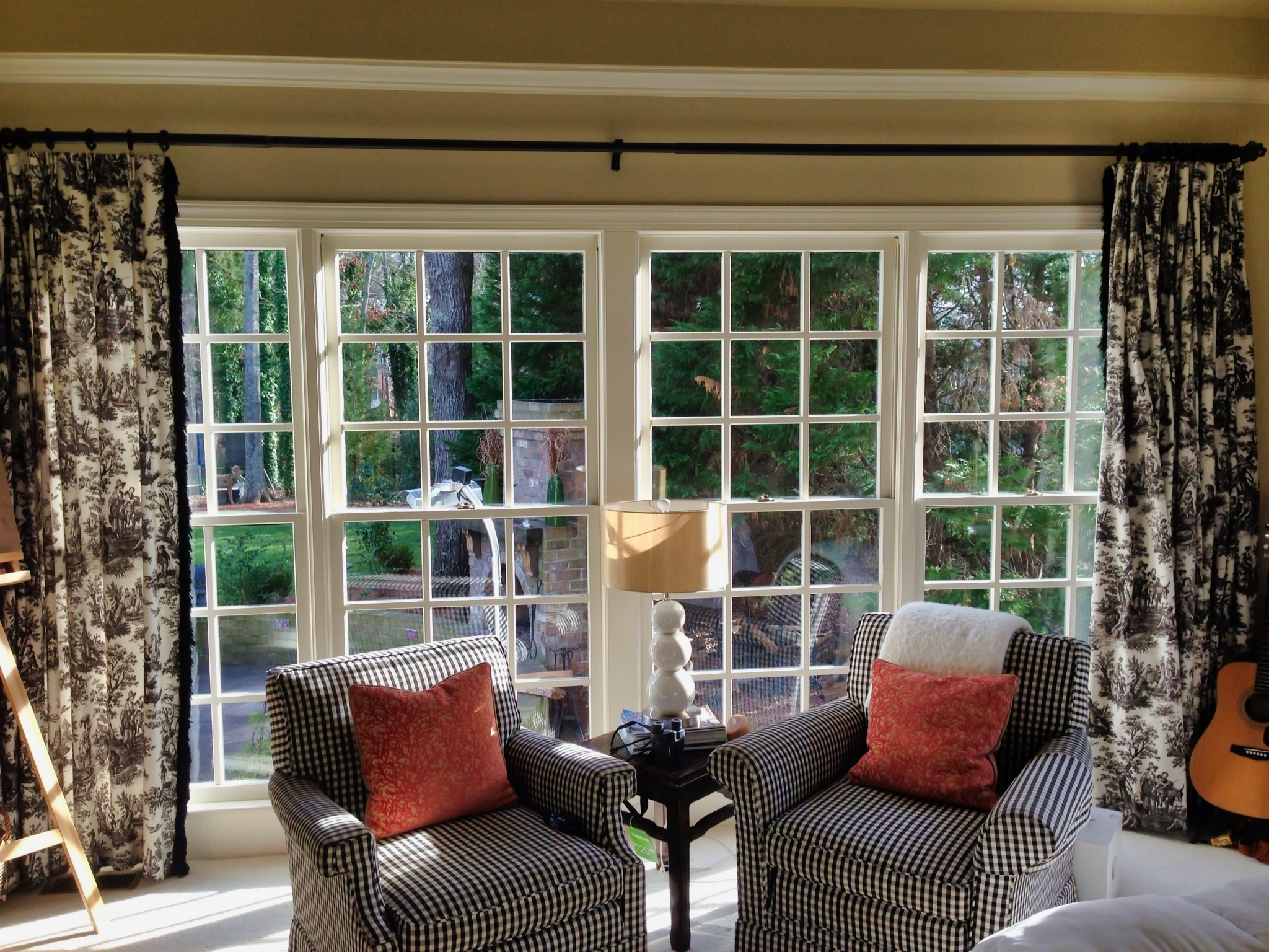 A bright living room with large pane windows.