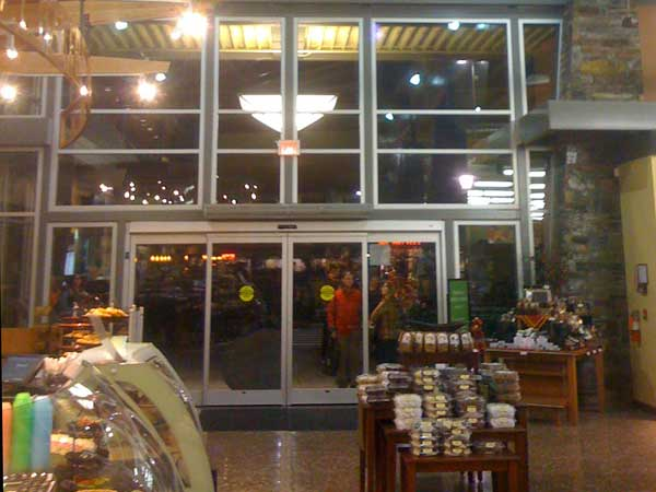 Interior store front windows that are very clean and reflecting store lights in Eugene Oregon.