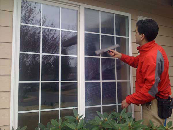 A close up of a window being cleaned in Eugene Oregon.