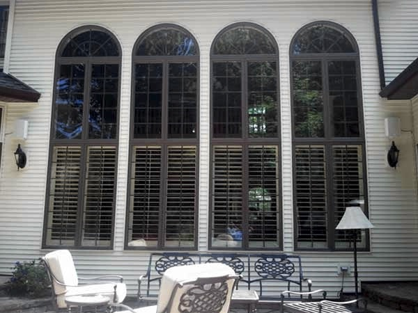 Four very tall windows that are streak free and have just been window cleaned in New York.