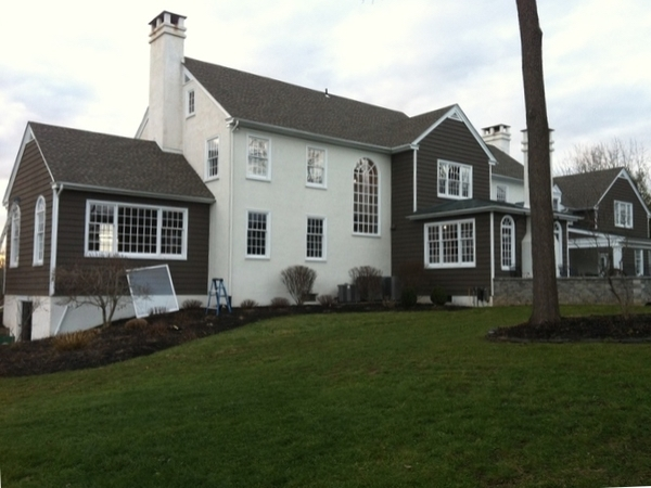 A grey and white home with many large newly cleaned windows in Yardley Pennsylvania.