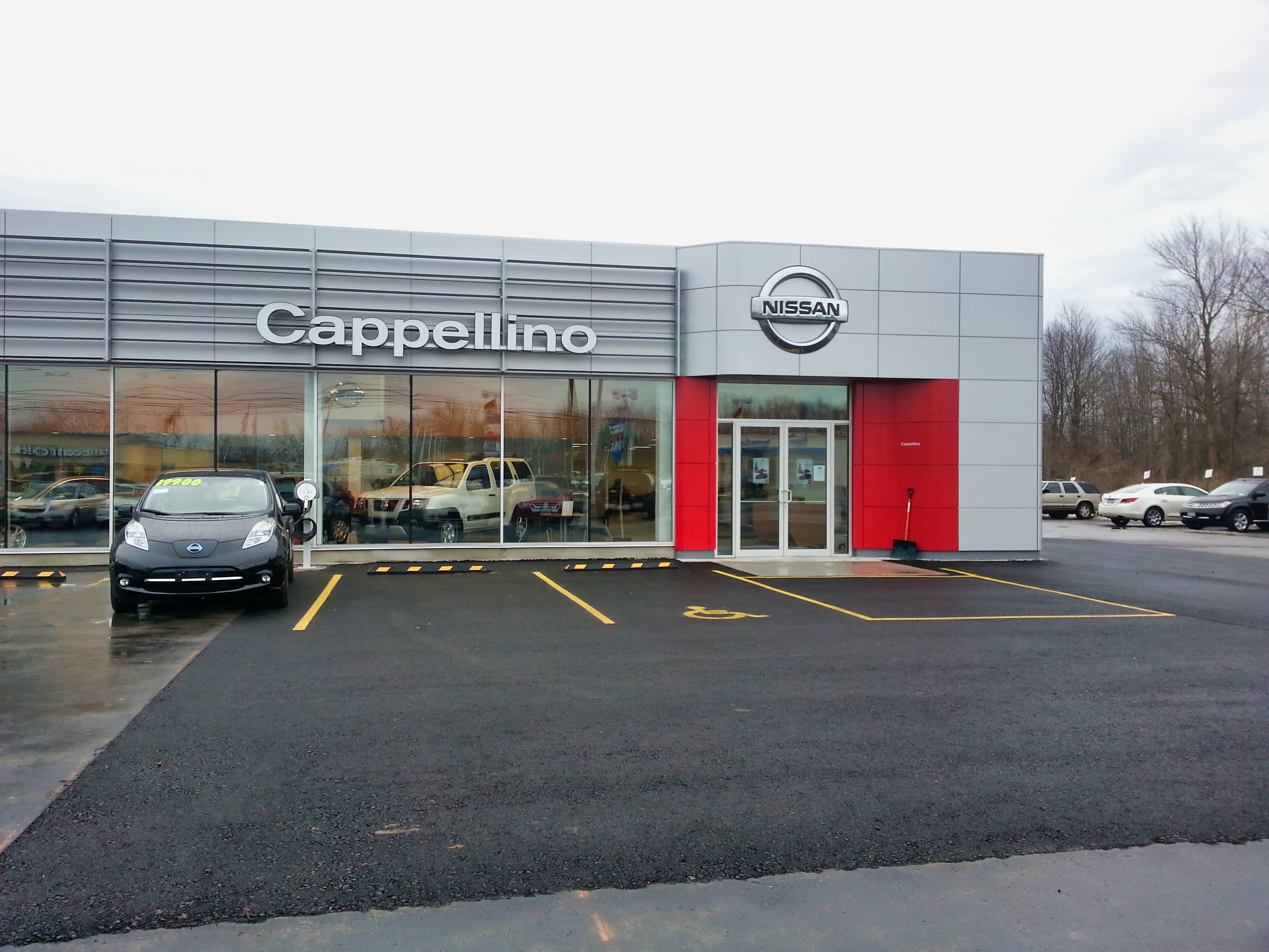 The exterior of a car dealership with floor to ceiling windows that are beautifully cleaned in Buffalo New York.