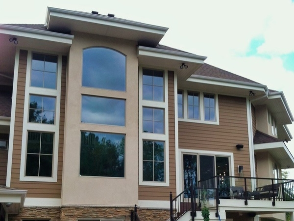 Large home with large wonderfully cleaned windows.