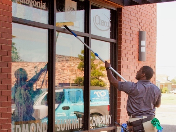 Store front window cleaning being done at a local business in Edmond Oklahoma