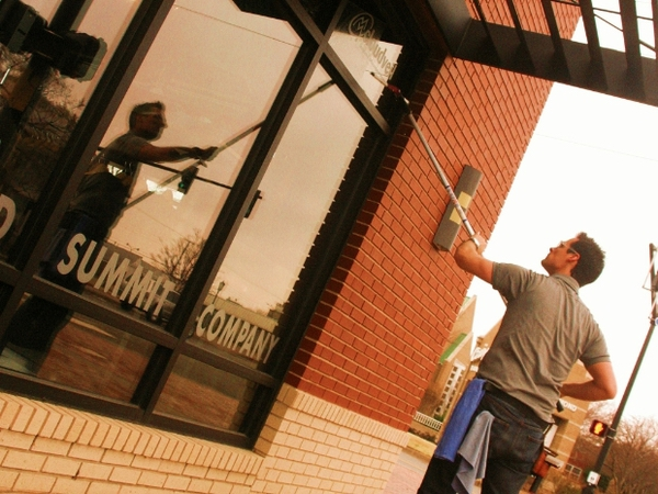 A local business is having their store front windows cleaned in Oklahoma City.