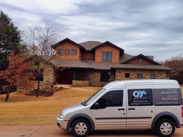 Oklahoma City window cleaners Optimum Maintenance company vehicle.