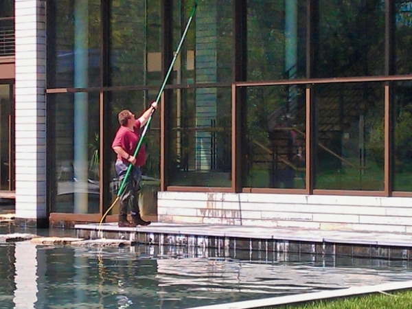 Window washing by a water fed pool at a commercial property in Springfield Ohio.