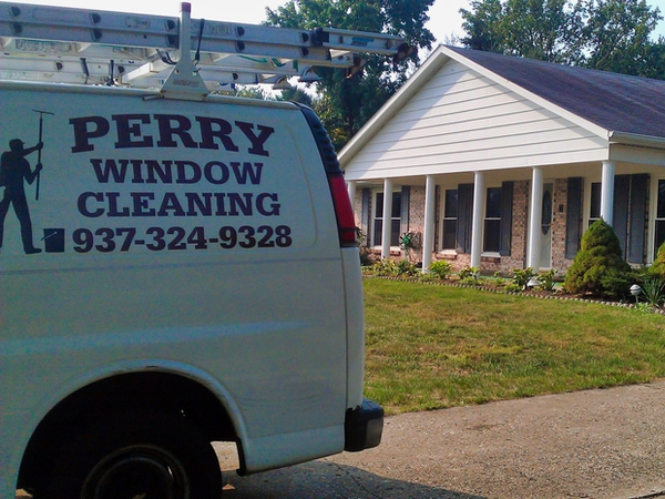 Professional window cleaners Perry WIndow Cleaning van parked outside a recently finished residential window cleaning job.