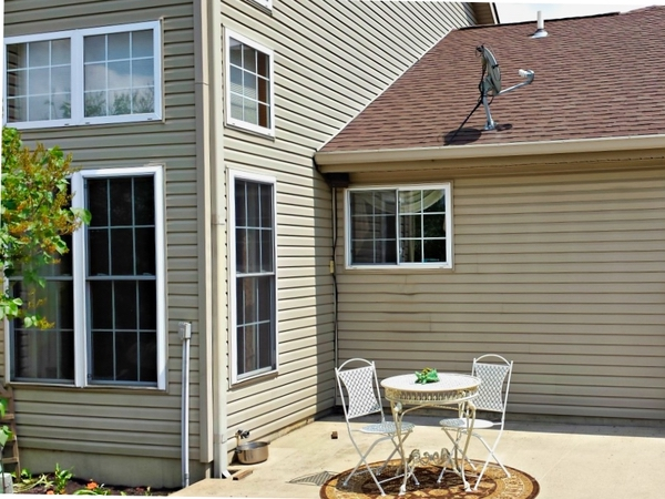In the back yard of a home in Springfield Ohio the windows stand out as brilliantly clean.