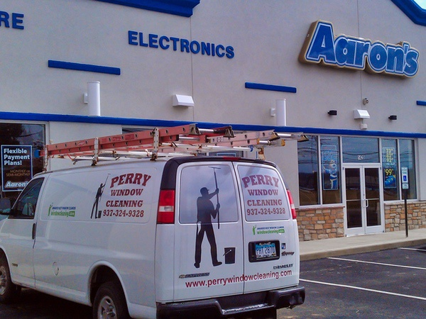 Perry Window Cleaning work van parked outside a local business that has their store front windows cleaned.