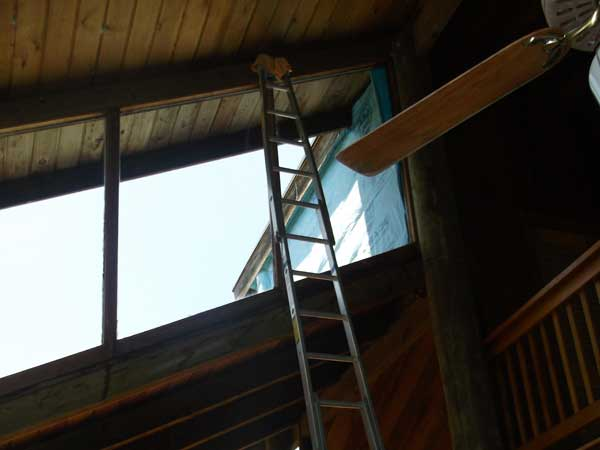 Interior home windows being prepped to be washed by using a ladder in Mililani.