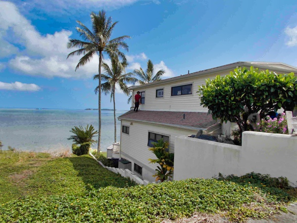 A beach front home in Hawaii getting its windows washed.