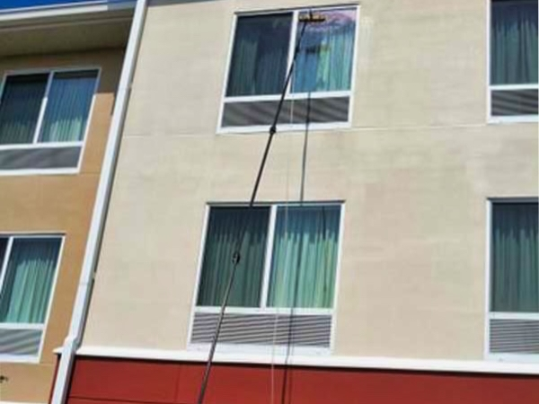 A hotel having its windows cleaned by pure water window cleaning in Benton Kentucky.