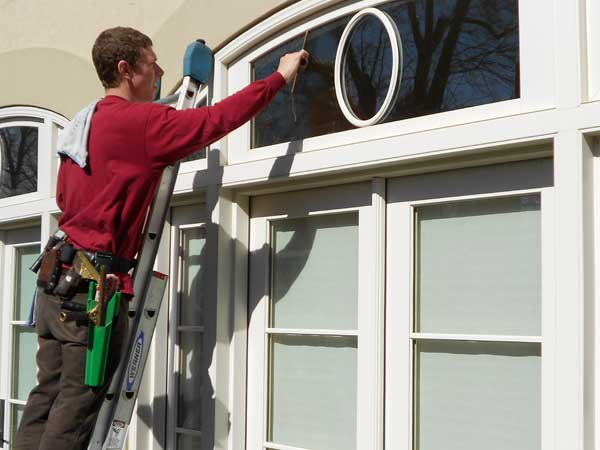 Friendly well trained window cleaner in Maryland squeegees windows to provide streak free results.