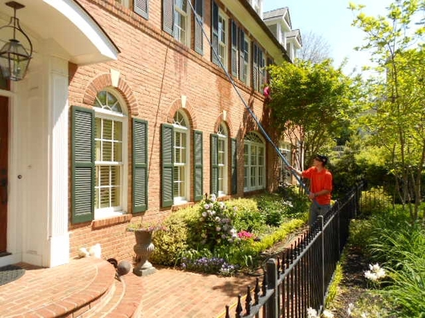 A stunning building having its windows cleaned by professionals in Rockville Maryland.