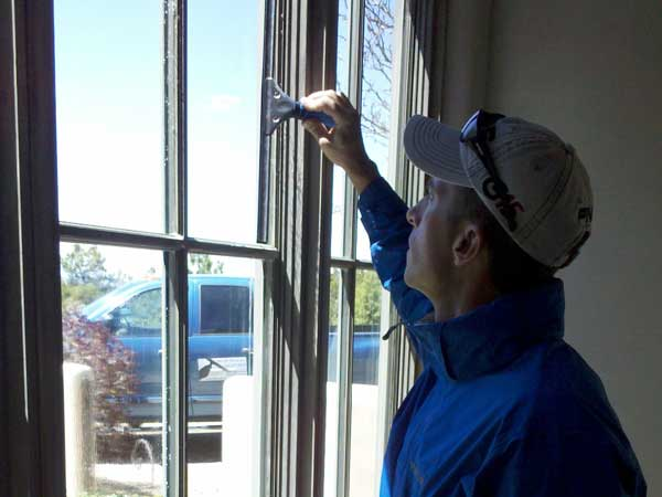 WIndow washing being done on pane windows in Santa Fe New Mexico.