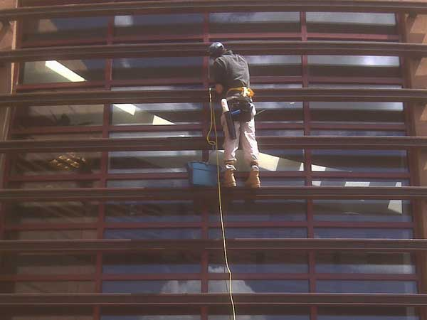 Commercial window cleaning job being done by window cleaner from We Do Windows Santa Fe.