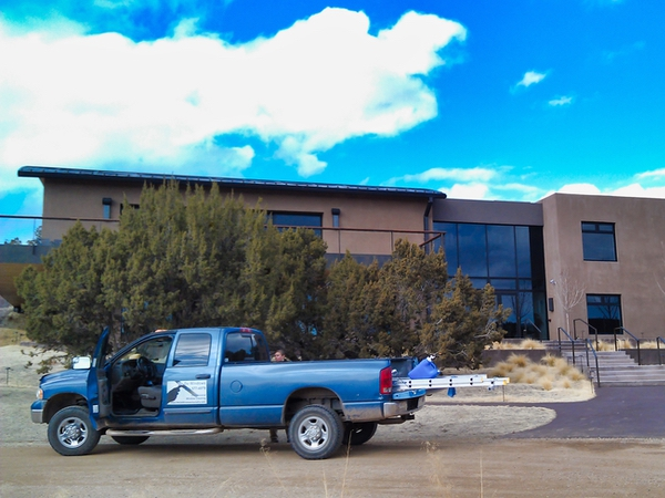 Company truck from We Do Windows Santa Fe parked outside their commercial window cleaning job.