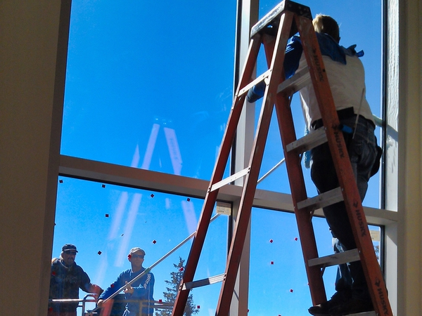 Window Cleaning team members working hard to clean interior and exterior windows at a place of business in New Mexico.