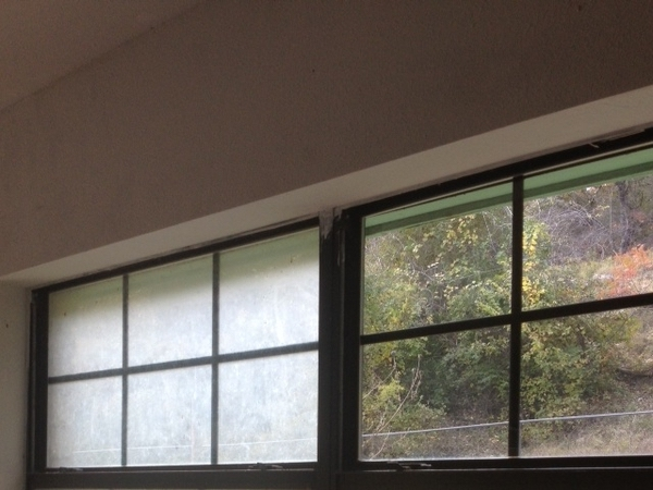 Home windows in the process of being professionally washed by Window Cleaning Inc.
