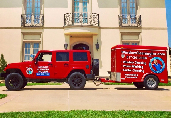 Window Cleaning Inc red jeep and trailer used in their many window cleaning jobs.