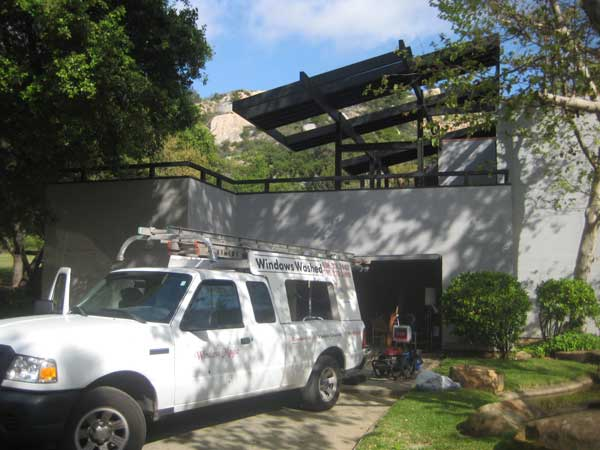 Best window cleaners of Chula Vista California truck parked in driveway of residential window cleaning job.