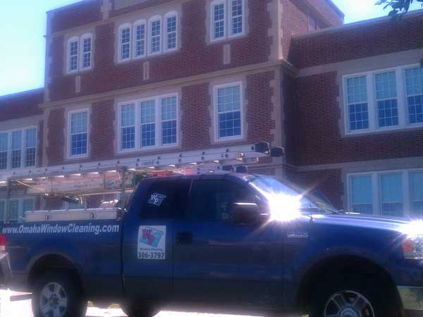 Professional window cleaners from Window Pro Inc have truck parked in front of commercial job.
