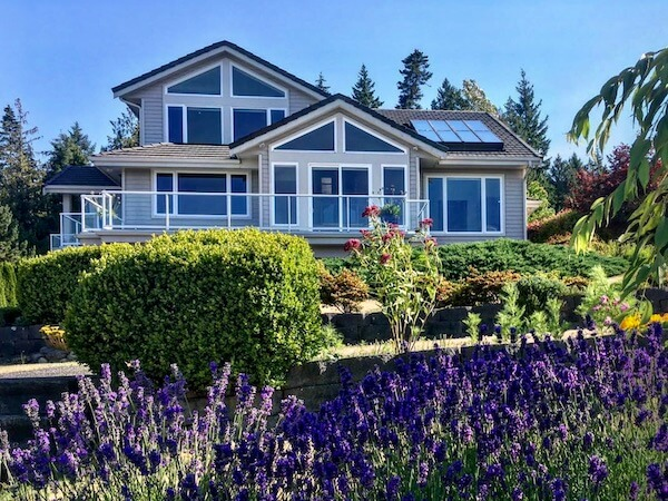 Home in Bellingham with a beautiful garden and meticulously clean windows.