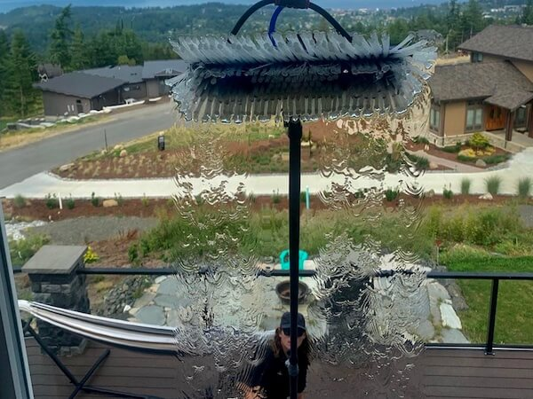 Specialized water fed pole cleaning a window in Bellingham.